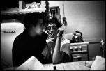 USA. New York City. 1959. Brooklyn Gang. Teenager couple smoking at a kitchen table.